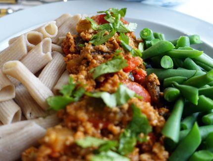 Indian 'Bolognaise' with noodles and greens
